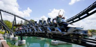 Guests try out the new Jurasic World VelociCoaster during a media preview at Universal Studios theme park Wednesday, June 9, 2021, in Orlando, Fla. The roller coaster will open to the public Thursday. (AP Photo/John Raoux)