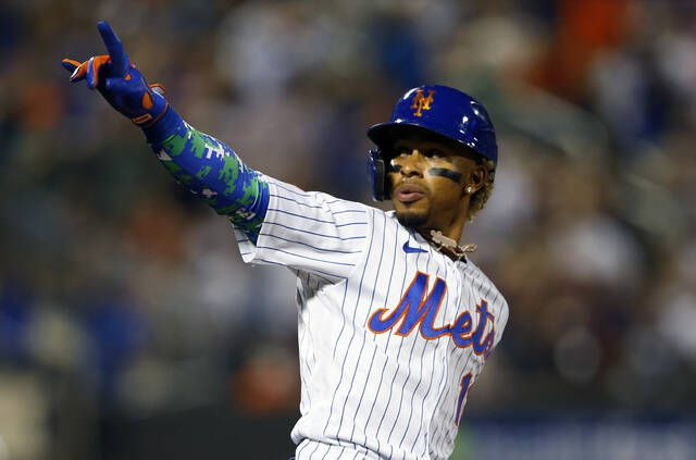 <p>The New York Mets' Francisco Lindor reacts after hitting a home run against the New York Yankees during the second inning of a game on Sunday in New York.</p>                                  <p>AP photo</p>