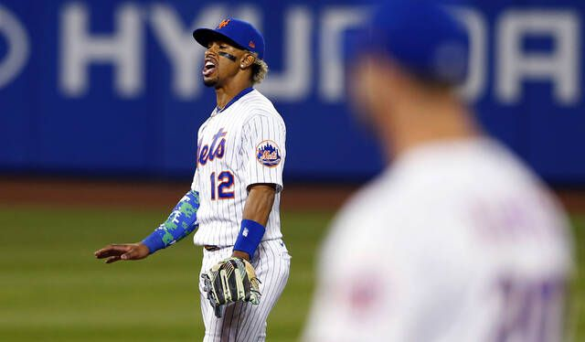 New York Mets short stop Francisco Lindor reacts after the New York Yankees' Giancarlo Stanton hit a home run in the seventh inning of a game Sunday in New York.                                  AP photo