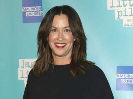 """FILE - Alanis Morissette attends the """"Jagged Little Pill"""" Broadway opening night in New York on Dec. 5, 2019. Just hours before the HBO documentary """"Jagged"""" was to premiere at the Toronto International Film Festival on Tuesday, Alanis Morissette criticized the film about her life as """"reductive"""" and """"salacious."""" Morissette participated in the film, directed by Alison Klayman, sitting for lengthy interviews. But in a statement issued by her publicist, Morissette said she would not be supporting the film. (Photo by Greg Allen/Invision/AP, File)"""